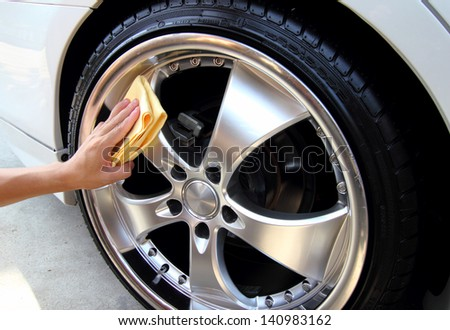 Sponge cleaning car wash - stock photo