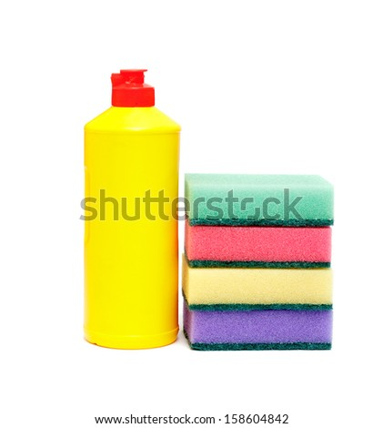 sponge for washing dishes and a bottle of liquid - stock photo