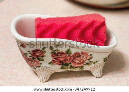 sponge for washing dishes, bright colors, washing glasses and dishes with detergent, Cleaning utensils kitchen sink sponge washing dish, housekeeping concept. - stock photo