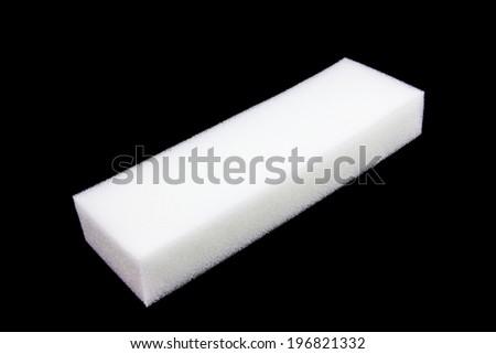 sponge isolated on black background - stock photo
