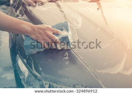 sponge over the car for washing  made with color filters. - stock photo