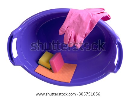 Sponges, rag for cleaning, rubber gloves in plastic basin, isolated on white  - stock photo
