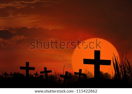 Spooky and ghostly graveyard with cross signs on them - stock photo