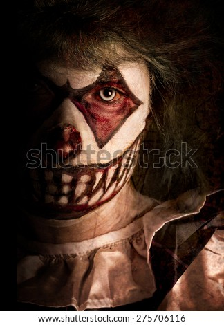 Spooky Clown hiding in the shadows - stock photo