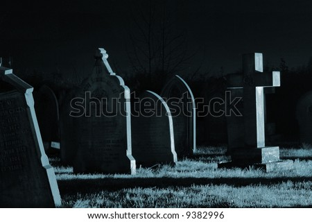 Spooky cold graveyard - stock photo