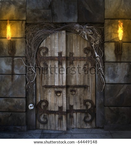 Spooky dungeon door flanked with two flaming torches and decorated with twigs and skeleton bones - stock photo