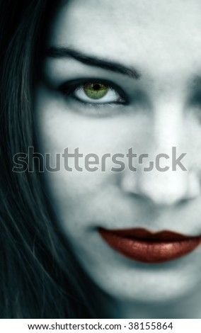 Spooky gothic woman with pale face and red lips - stock photo