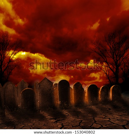 Spooky graveyard with burning sky - stock photo