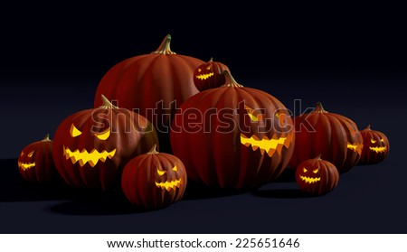 Spooky Halloween jack-o'-lanterns with evil faces glowing in the dark - stock photo