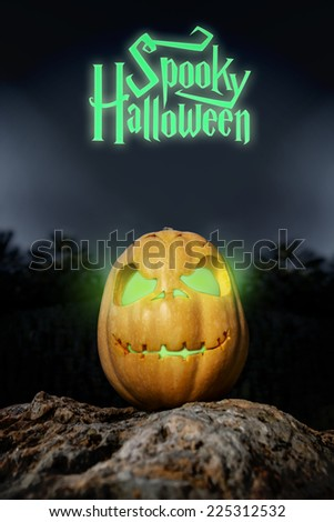 Spooky Halloween neon and scary pumpkin jack-o-lantern with a smile on a rock from bottom perspective template illustration from the darkness  - stock photo