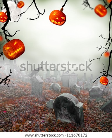 Spooky halloween pumpkins on cemetery - stock photo