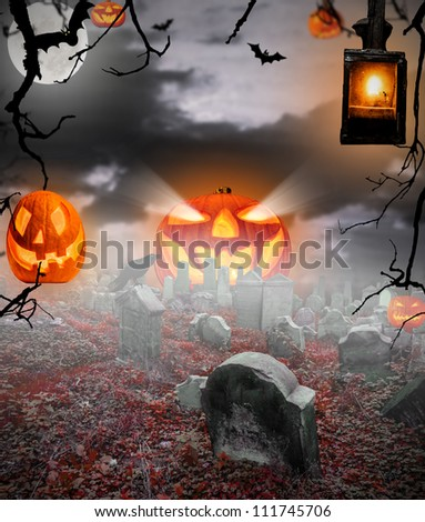 Spooky halloween ruined cemetery - stock photo
