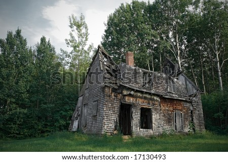 Spooky haunted house among the trees. - stock photo
