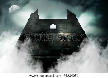 Spooky Is The Chilling Scene During A Horror Full Moon As Mist Rises From The Ruins Of A Old Haunted Castle - stock photo