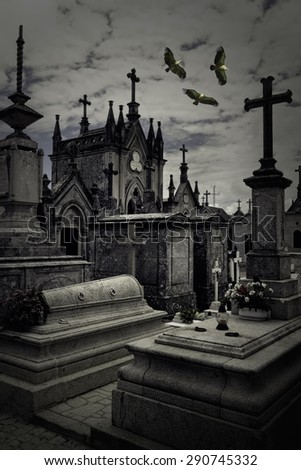 Spooky old european cemetery overflown by griffins. Used some digital filters. - stock photo