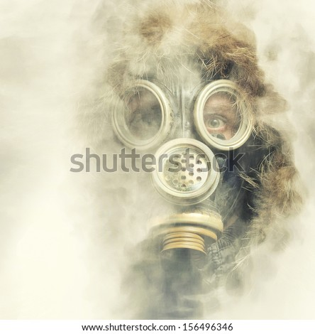 Spooky portrait of man in respirator - stock photo
