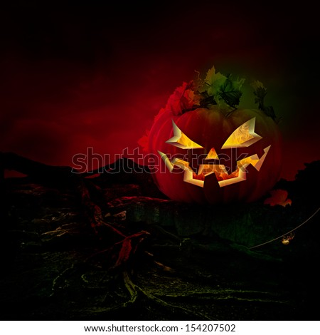 Spooky Scary Laughing Jack O Lantern Carved Pumpkin With Burning Fire Flames Halloween Holiday Grunge Background With Ghostly Orange Light, Glowing Green Rocks & Old Twisted Tree Roots Text Copy Space - stock photo