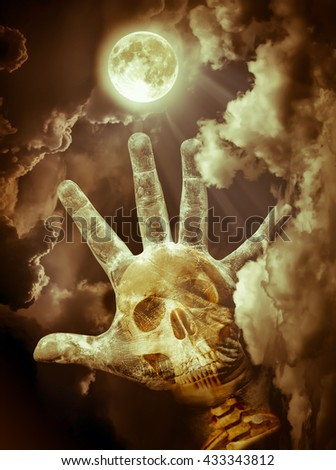 Spooky skull combined with dirty palm on nightly sky and clouds with bright full moon for halloween background. Hand up to sky. The moon taken with my own camera, no NASA images used. Sepia tone. - stock photo