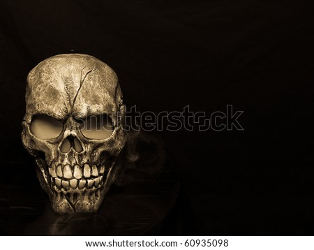 Spooky steaming skull in sepia.  Happy Halloween! - stock photo