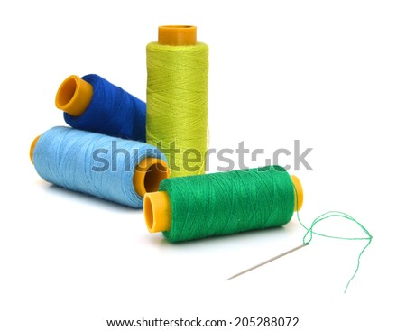 Spool of green thread and needle isolated on white background - stock photo