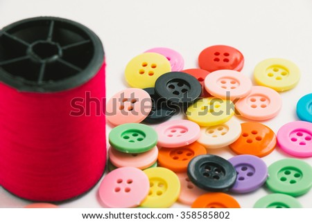 Spool of thread and buttons, sew instrument isolated on white background - stock photo