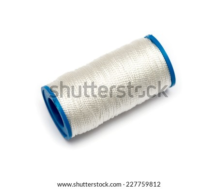 Spool of thread isolated on white background - stock photo