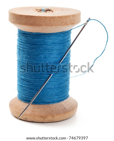 Spool of thread with needle isolated on white - stock photo