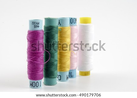 Spools of colorful silk thread. Copy space