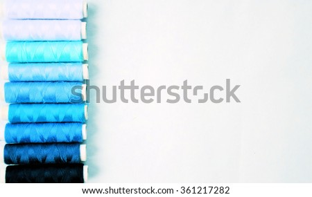 spools of thread for sewing, background with copy space for text or logo - stock photo