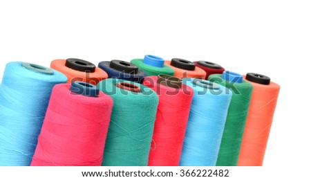 Spools of thread isolated on a white background - stock photo