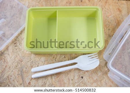 spoon and fork and empty lunch box for food storage