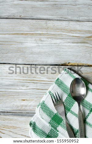 Spoon and fork on a wooden table. - stock photo