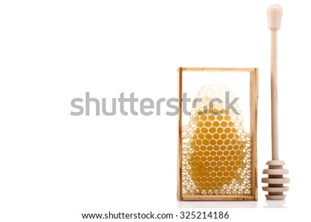 spoon for honey and honey honeycombs isolated on white background - stock photo