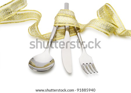 Spoon, fork and a knife tied up celebratory ribbon. It is isolated on a white background - stock photo