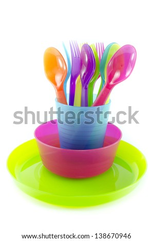 spoon fork cup and bowl Plastic ware with white isolate background - stock photo