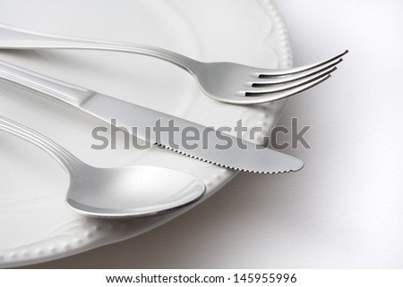 Spoon , fork , knife and dish on white background