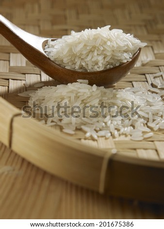 spoon full of rice on bamboo tray