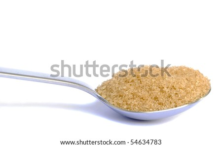 Spoon of brown sugar - stock photo