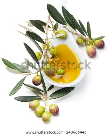 spoon of olive oil with  fresh olives and olive twig  isolated on white background