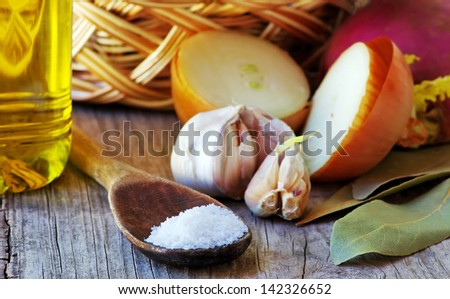 Spoon of salt, spices and olive - stock photo