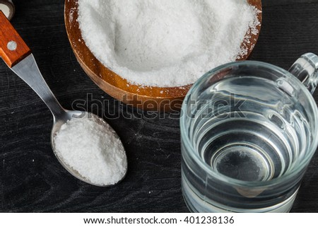 Spoon of salt, sugar, soda with glass of water - stock photo
