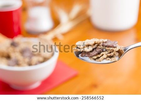 Spoon with cereals, coffee and cupcake - stock photo