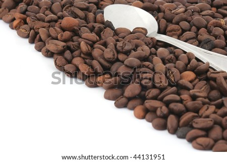 spoon with coffee at white background
