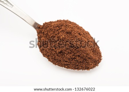Spoon With Coffee On A White Background - stock photo
