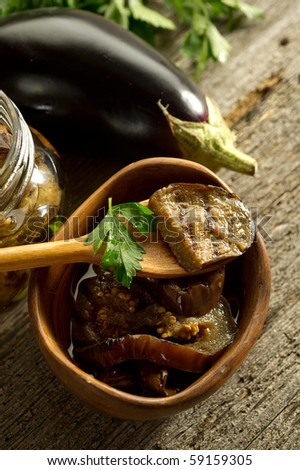 spoon with grilled eggplants preserved - stock photo