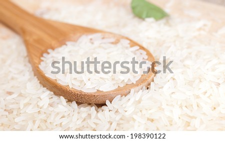 spoon with rice - stock photo