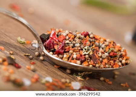 Spoon with spices on the table, close-up - stock photo