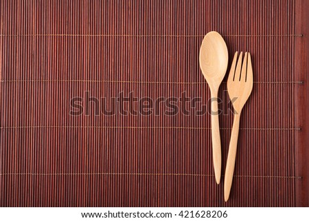 spoon wood kitchenware on bamboo mat background. - stock photo