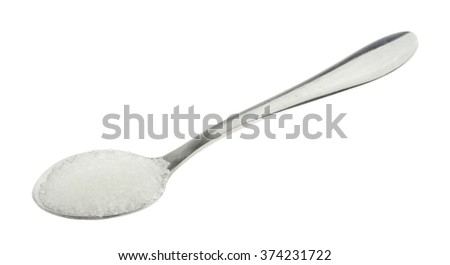 Spoonful of white sugar isolated on white background - stock photo