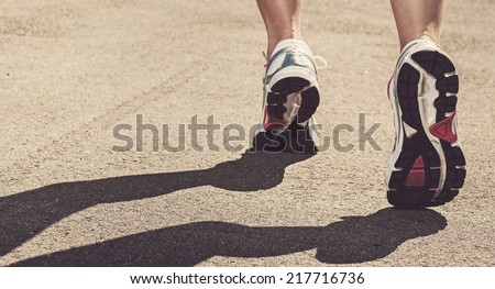 Sport, active. Runner on the street - stock photo